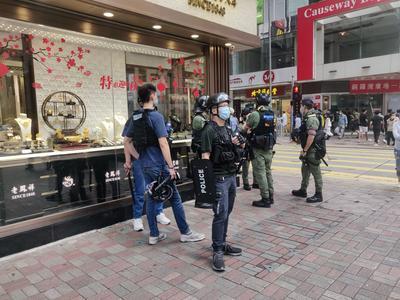 Hongkong suitsii kovalla kädellä mielenosoitusyrityksiä Kiinan kansallispäivänä